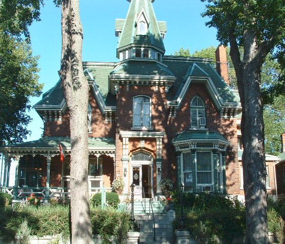 A beautiful sunny facade of a stately home in Kingston, Ontario.