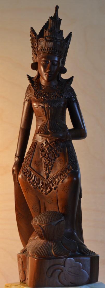 Hand carved from teak, this sculpture dates from around the 1930. The Goddess protects the crops.